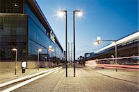 View of light trails on street on modern city at dusk Stock Photo - Premium Royalty-Freenull, Code: 698-06374795