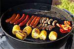 Sausages and corncobs on barbecue grill Stock Photo - Premium Royalty-Free, Artist: CulturaRM, Code: 698-06374867