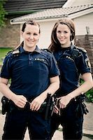 female police officer happy - Portrait of two female police officers standing together Stock Photo - Premium Royalty-Freenull, Code: 698-06374902