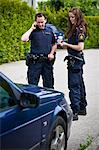 Two female officers standing by car on road Stock Photo - Premium Royalty-Free, Artist: Matt Brasier, Code: 698-06374905