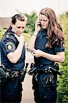 Two female police officers at work Stock Photo - Premium Royalty-Free, Artist: Cultura RM, Code: 698-06374906