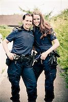 female police officer happy - Portrait of two female police officers standing together Stock Photo - Premium Royalty-Freenull, Code: 698-06374908