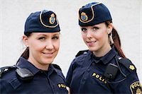 female police officer happy - Portrait of two female police officers Stock Photo - Premium Royalty-Freenull, Code: 698-06374915