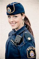 female police officer happy - Portrait of a happy young female police officer Stock Photo - Premium Royalty-Freenull, Code: 698-06374917
