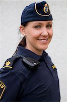 female police officer happy - Portrait of a happy female police officer Stock Photo - Premium Royalty-Freenull, Code: 698-06374918