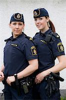 female police officer happy - Portrait of two confident female police officers standing together Stock Photo - Premium Royalty-Freenull, Code: 698-06374919