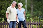 Senior couple looking at each other while standing in garden Stock Photo - Premium Royalty-Free, Artist: Blend Images, Code: 698-06374950