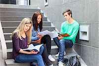 Young students studying on steps in university Stock Photo - Premium Royalty-Freenull, Code: 698-06374987