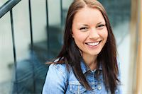Portrait of a happy young female university student smiling Stock Photo - Premium Royalty-Freenull, Code: 698-06375010