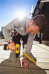Manual worker drilling nail on floorboard against sunbeam Stock Photo - Premium Royalty-Free, Artist: Cultura RM, Code: 698-06375233