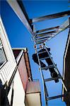 Low angle view of man climbing ladder against clear sky Stock Photo - Premium Royalty-Free, Artist: Cultura RM, Code: 698-06375236