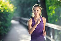 Healthy female jogging down track Stock Photo - Premium Royalty-Freenull, Code: 698-06375325