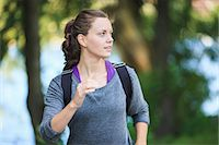 Young woman looking away as she jogs Stock Photo - Premium Royalty-Freenull, Code: 698-06375341