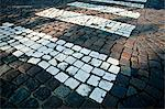 Road markings on cobblestoned road Stock Photo - Premium Royalty-Free, Artist: Westend61, Code: 698-06375472