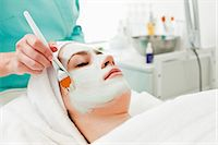 facial - Young woman receiving a beauty treatment with make-up brush in health spa Stock Photo - Premium Royalty-Freenull, Code: 698-06375508