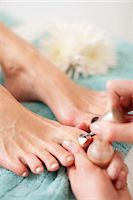 Close-up of a beautician applying nail polish on female customer's toenail in beauty spa Stock Photo - Premium Royalty-Freenull, Code: 698-06375543