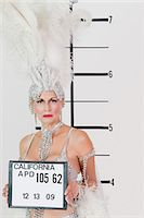 Mug shot of senior showgirl holding plaque Stock Photo - Premium Royalty-Freenull, Code: 693-06378834