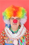 Senior male clown frowning over red background Stock Photo - Premium Royalty-Free, Artist: ableimages, Code: 693-06378846