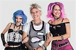 Portrait of senior man with punk females over gray background Stock Photo - Premium Royalty-Free, Artist: AWL Images, Code: 693-06378864