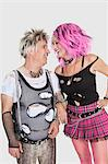Happy senior punk couple looking at each other over gray background Stock Photo - Premium Royalty-Free, Artist: Ron Fehling, Code: 693-06378972