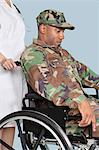 Soldier wearing camouflage uniform in wheelchair assisted by female nurse Stock Photo - Premium Royalty-Free, Artist: Zoran Milich, Code: 693-06379128