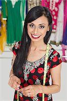 Portrait of beautiful Indian female tailor smiling Stock Photo - Premium Royalty-Freenull, Code: 693-06379278