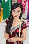 Portrait of beautiful Indian female tailor smiling Stock Photo - Premium Royalty-Free, Artist: Blend Images, Code: 693-06379278