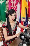 Portrait of an Indian female dressmaker using sewing machine Stock Photo - Premium Royalty-Free, Artist: Blend Images, Code: 693-06379287