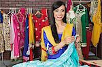 Portrait of an Indian female dressmaker working at design studio Stock Photo - Premium Royalty-Free, Artist: Blend Images, Code: 693-06379308