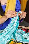 Midsection of dressmaker working on a sari Stock Photo - Premium Royalty-Free, Artist: Blend Images, Code: 693-06379309