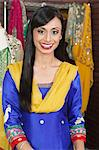 Portrait of an attractive Indian female dressmaker smiling Stock Photo - Premium Royalty-Free, Artist: Blend Images, Code: 693-06379311