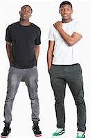 Portrait of two young men in casuals over gray background Stock Photo - Premium Royalty-Freenull, Code: 693-06379523