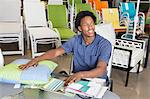Male African American salesperson working in garden furniture store Stock Photo - Premium Royalty-Free, Artist: CulturaRM, Code: 693-06379611