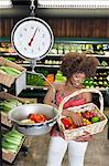 African American woman weighing bell peppers on scale at supermarket Stock Photo - Premium Royalty-Free, Artist: AWL Images, Code: 693-06379614