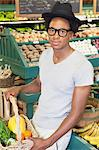 Portrait of an African American man with vegetable basket at supermarket Stock Photo - Premium Royalty-Free, Artist: AWL Images, Code: 693-06379620