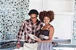 Portrait of young African American couple with color swatches in new kitchen Stock Photo - Premium Royalty-Free, Artist: Angus Fergusson, Code: 693-06379623