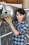 Female industrial worker carrying a propane cylinder Stock Photo - Premium Royalty-Free, Artist: Science Faction, Code: 693-06379675