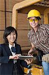 Portrait of female inspector and industrial worker using tablet PC Stock Photo - Premium Royalty-Free, Artist: Blend Images, Code: 693-06379689