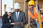Engineers and female industrial worker looking at tablet PC Stock Photo - Premium Royalty-Free, Artist: Uwe Umstätter, Code: 693-06379705