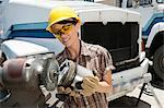 Female industrial worker buffing a truck engine cylinder Stock Photo - Premium Royalty-Freenull, Code: 693-06379725