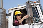 Asian female industrial worker adjusting mirror while sitting in logging truck Stock Photo - Premium Royalty-Free, Artist: Ron Fehling, Code: 693-06379728