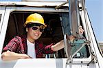 Female industrial worker adjusting mirror while sitting in logging truck Stock Photo - Premium Royalty-Free, Artist: Blend Images, Code: 693-06379729