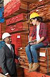 Female industrial worker and male engineer smiling while looking at each other at timber yard Stock Photo - Premium Royalty-Free, Artist: Uwe Umstätter, Code: 693-06379737