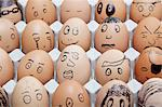 Funny faces on painted on brown eggs arranged in carton Stock Photo - Premium Royalty-Free, Artist: Ikon Images, Code: 693-06379764