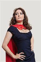 superhero - Beautiful woman in superhero costume over gray background Stock Photo - Premium Royalty-Freenull, Code: 693-06380089