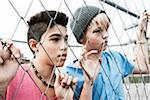 Two Boys Looking Through Chain Link Fence, Mannheim, Baden-Wurttemberg, Germany Stock Photo - Premium Royalty-Free, Artist: Uwe Umstätter, Code: 600-06382848