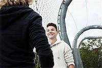 Girl and Boy Talking in Playground, Mannheim, Baden-Wurttemberg, Germany Stock Photo - Premium Royalty-Freenull, Code: 600-06382874