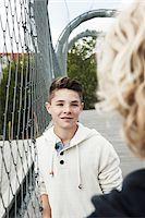 preteen girl boyfriends - Girl and Boy Talking in Playground, Mannheim, Baden-Wurttemberg, Germany Stock Photo - Premium Royalty-Freenull, Code: 600-06382875