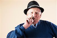 Portrait of Senior Man Smoking Cigar Stock Photo - Premium Royalty-Freenull, Code: 600-06382926