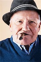 Portrait of Senior Man Smoking Cigar Stock Photo - Premium Royalty-Freenull, Code: 600-06382927